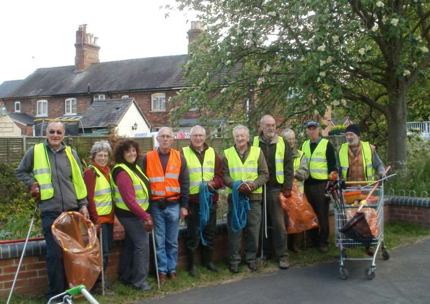 Members of Grantham Rivercare with some of the items and rubbish collected from the Witham.