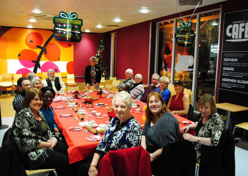 Charity shop volunteers are treated to Christmas dinner at Sainsbury's.
