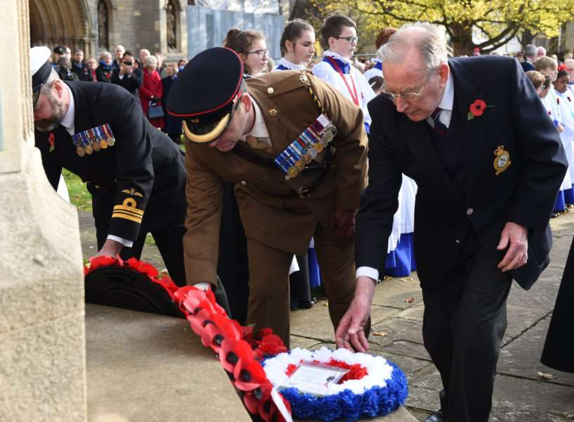 Laying wreaths at the war memorial on Remembrance Sunday.