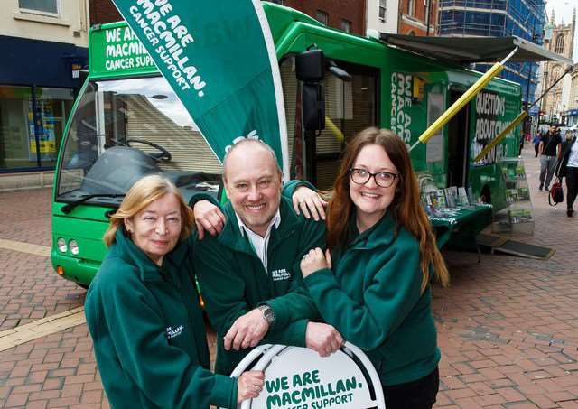 From left Margaret Watts (information specialist), Jeremy Burman (facilities officer) and Moray Hayman information specialist) with Betty, the Macmillan mobile information bus.