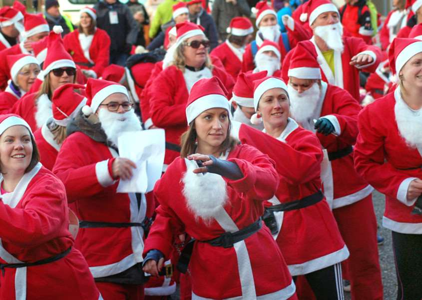 The Santas warm-up before the start PHOTO: Tim Williams