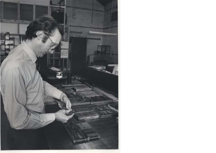 Grantham Journal advertising manager Mick Townsend uses a composing stick to assemble lead type in the Journal commercial department.