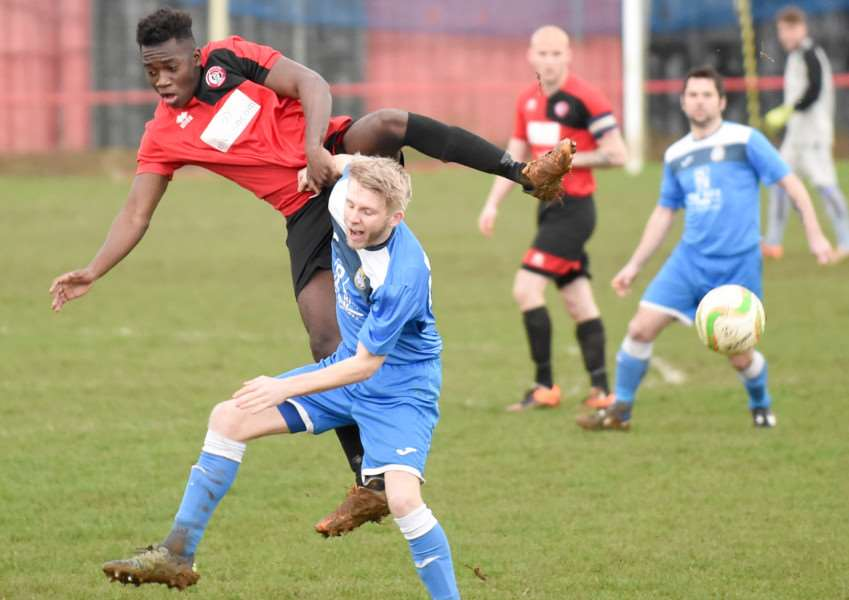 Harrowby United's Ngoni Dongo challenges for a high ball in acrobatic fashion on Saturday. Photo: Toby Roberts