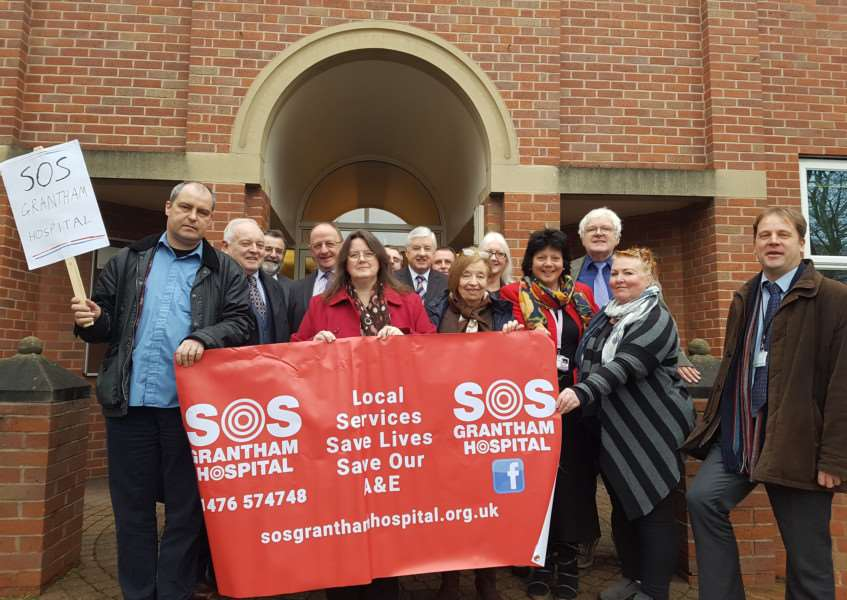 South Kesteven councillors gather before the meeting of the district council demanding the return of full A&E services at Grantham Hospital.