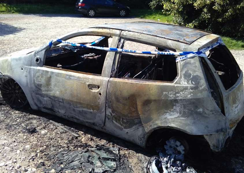 The burnt-out car at Londonthorpe Wood.