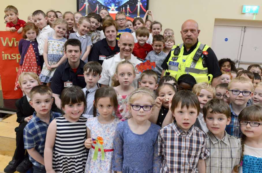 Children and inspirational figures at the 'Who Inspires us' awards at Little Gonerby Infant School. Pictured with the children are Grantham firemen Kyle Campbell, Steven waters, Chris Stanford and policeman Pete Nettleton.