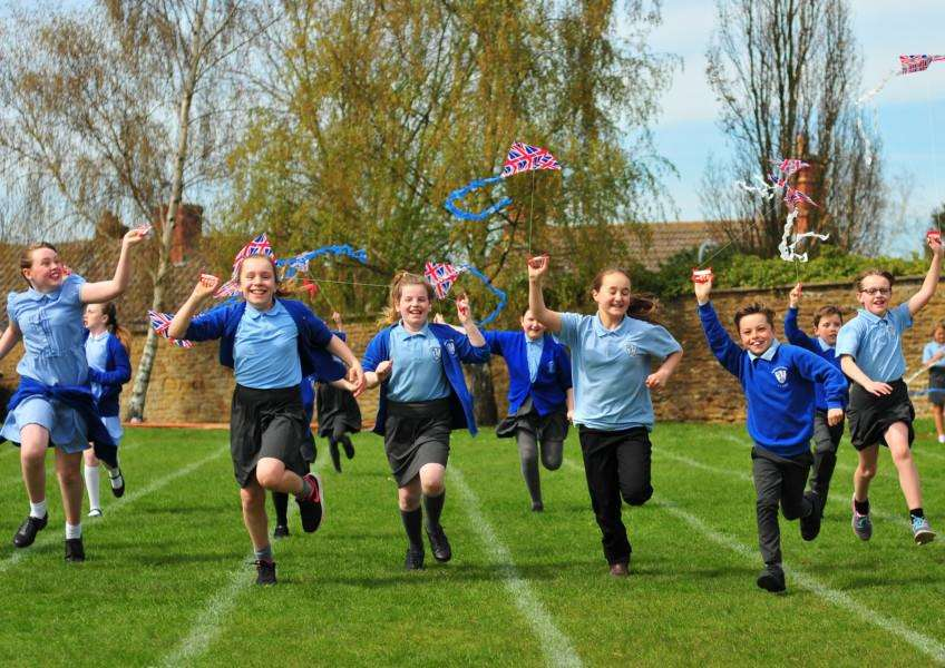 Flying kites at Barkson and Syston Primary School for the Queen's 90th birthday. Photo: M. Bailey