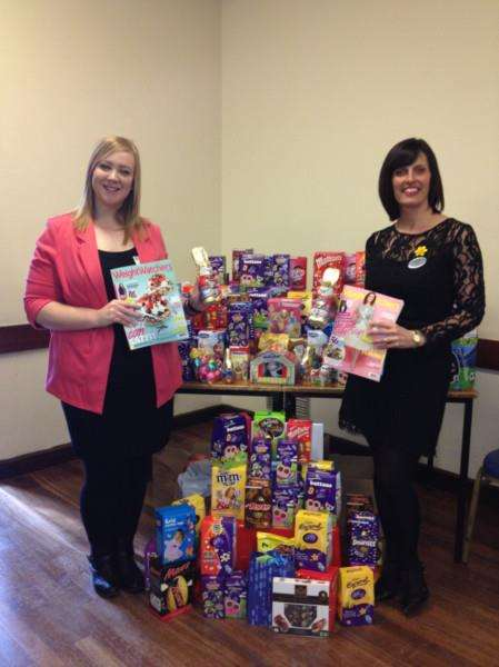 Hospice representative Lauren Alexander and Weight Watchers Diamond Leader Tracy Ferguson with the eggs donated to St Andrew's Hospice from members of Weight Watchers.
