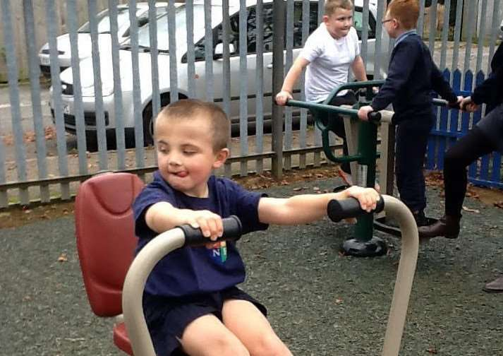Children at Ambergate enjoy the new play equipment in the playground.