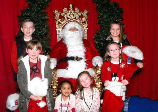 Santa at Downtown, with competition winners.