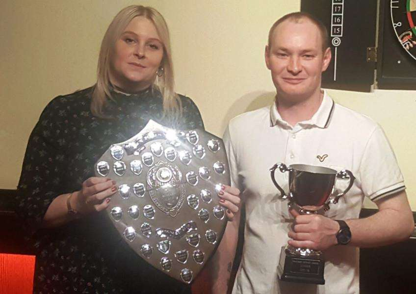 League champion Johnny Baker collects his trophy from Tracie Morton.