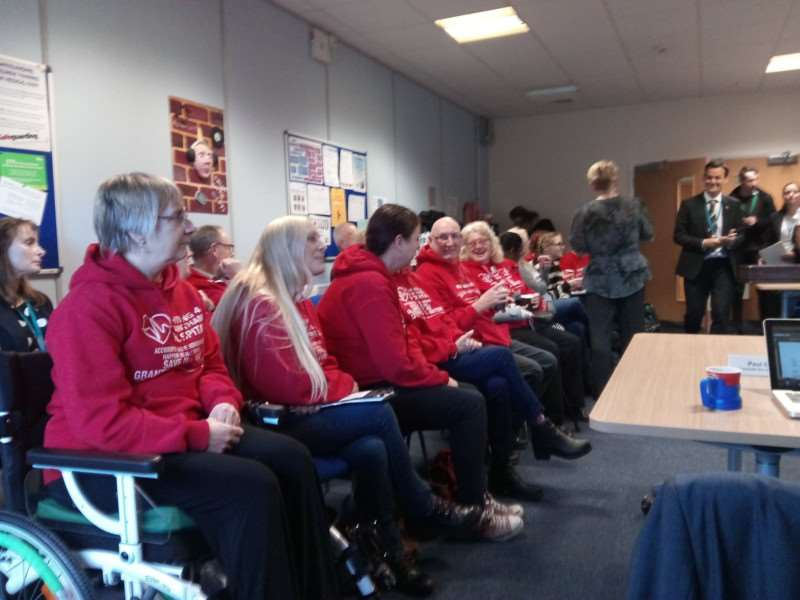 Campaigners gather to hear news about the reopening of Grantham's A&E at a meeting of the ULHT board.