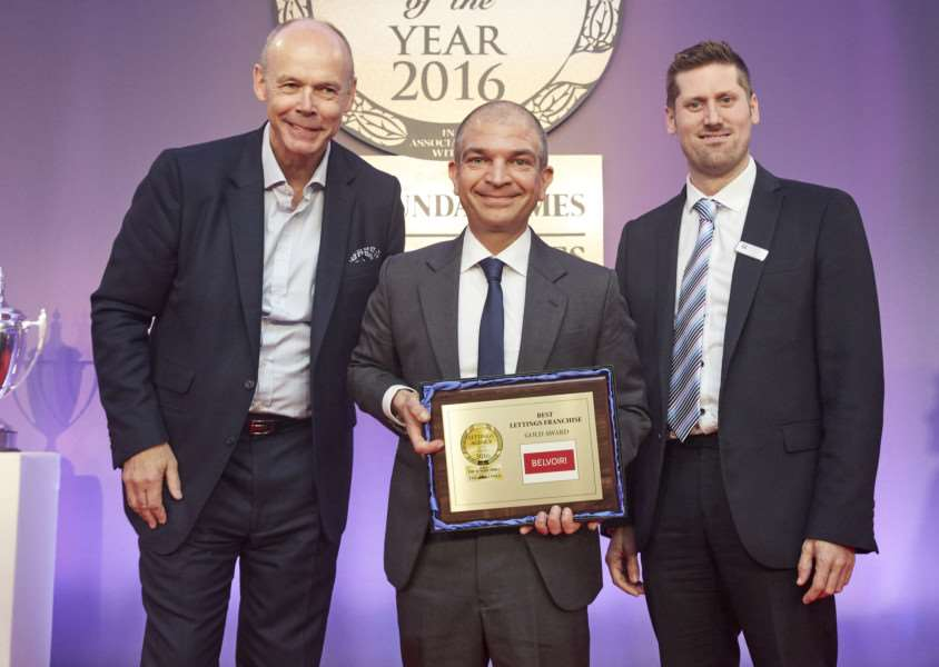 Belvoir managing director Dorian Gonsalves, centre, collects the award from awards' host Sir Clive Woodward and Chris Leonard, representing Deposit Protection Service, the award sponsor.