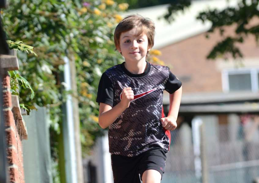 Eight-year-old Finn JKR is raising money for Cancer Research by running one mile a day for 26 days for Cancer Research.