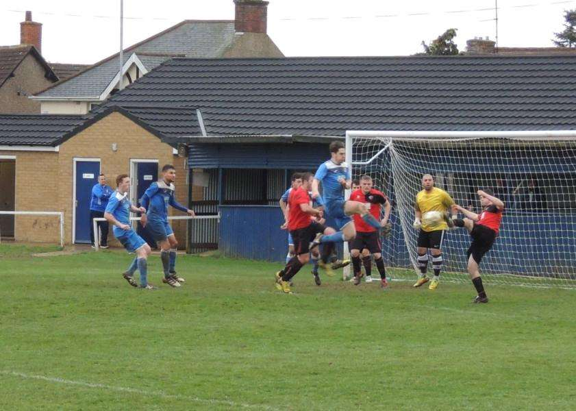 Ben Sharpe clears a corner for the Arrows.