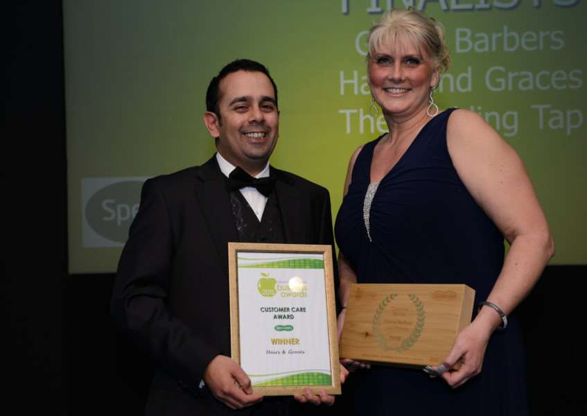 Bijal Ladva, of sponsors Specsavers, presents Debbie Redford with her award.