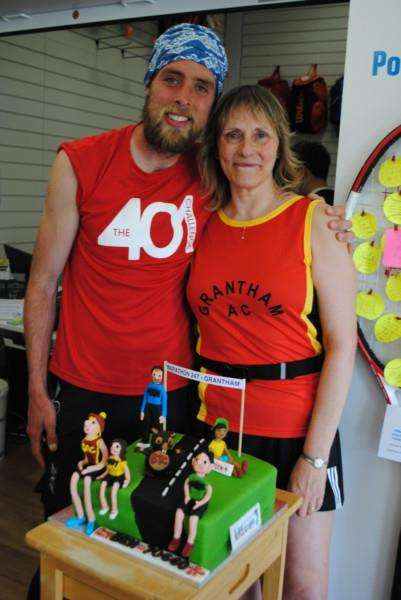 Ben Smith with Dona Hall of Grantham Athletic Club, who made him a special cake presented at Grantham Tennis Centre.