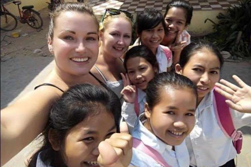 Patsy Boguzas with children in Cambodia.