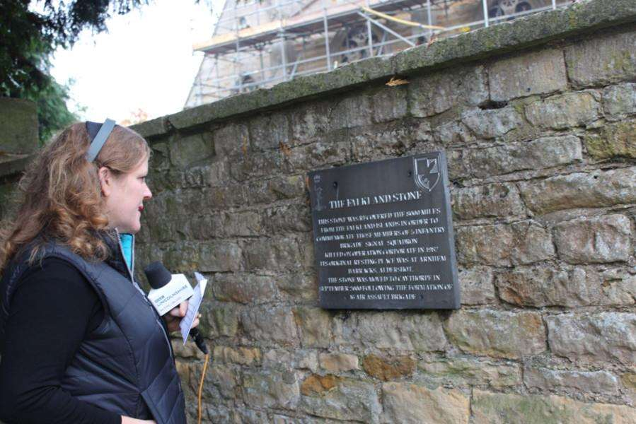 Pirate Gold reporter Amanda White examines the plaque commemorating 216 Squadron losses in the Falklands War.