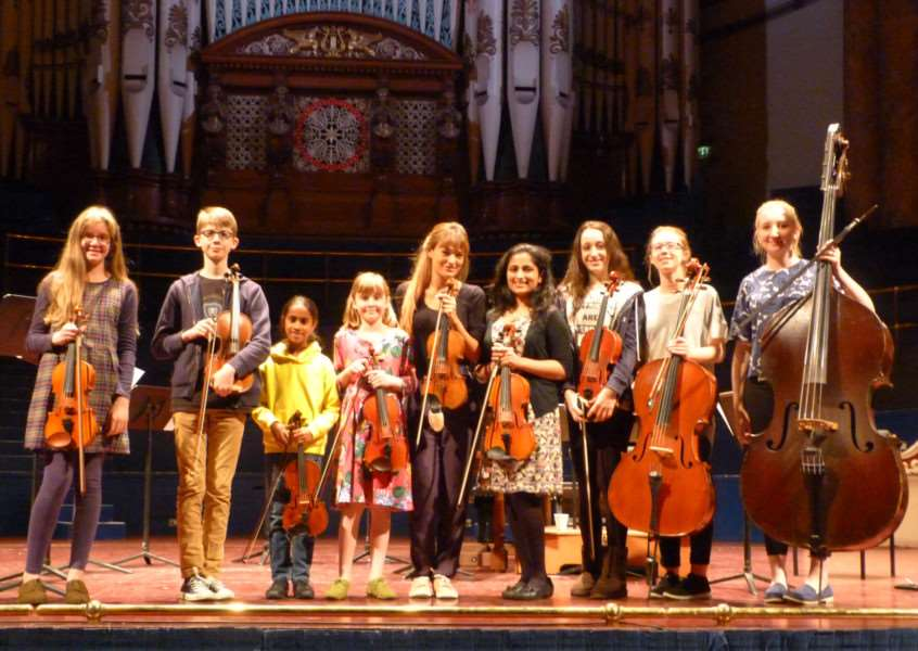 Oasby Music Group violinists join Nicola Benedetti in Leeds Town Hall.