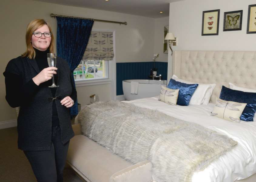 Licensee Jo Chad surveys one of the new boutique bedrooms.