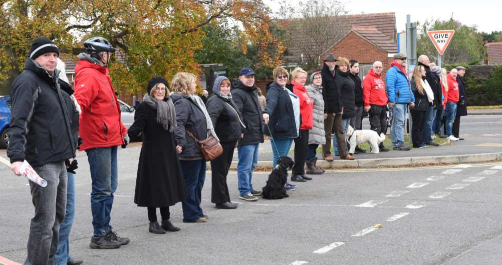 Protesters hold hands in front of Grantham Hospital.