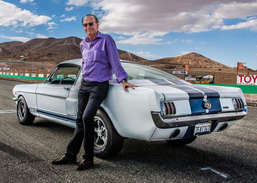 Quentin Willson posing alongside a beautiful 1967 Ford Mustang GT350 fastback. Credit: PA Photo/Channel 5/WiseOldFoxLtd.
