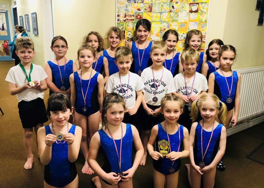 Allington with Sedgebrook Church of England School gymnasts show off their medals.
