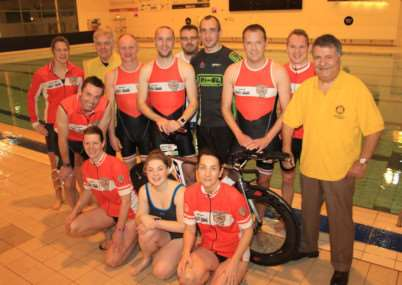 Rotarians John Cussell, second left, and Mos Kalbassi, right, with the Belvoir Triathlon Club following an early morning training session.