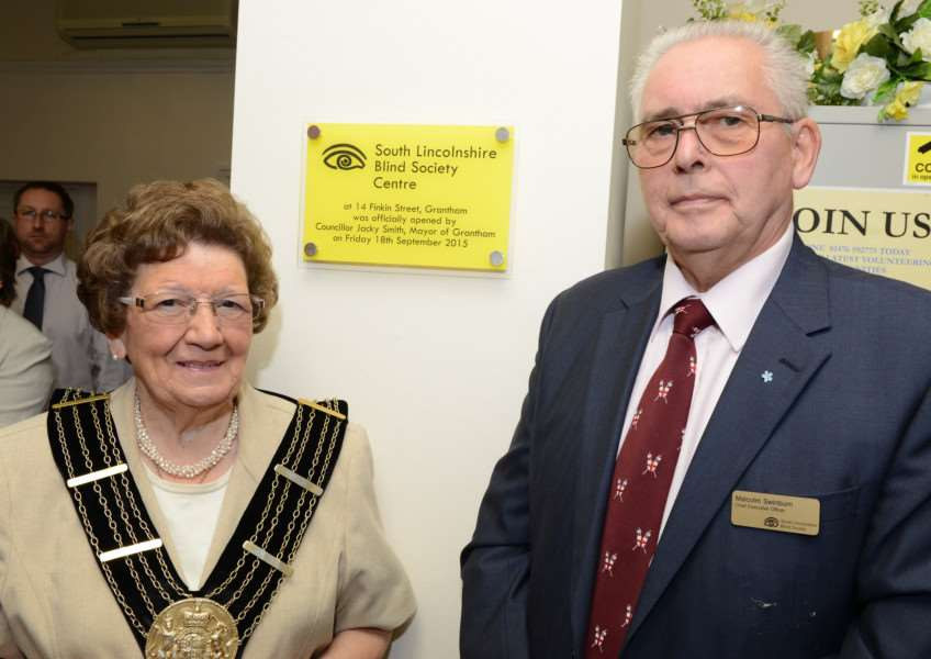 Mayor of Grantham Jacky Smith officially opens the new South Lincolnshire Blind Society premises in Finkin Street, Grantham, with Chief Executive Malcolm Swinburn.