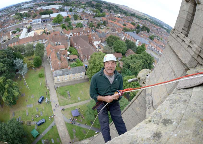 Stephen Welton braves the abseil challenge down St Wulfram's tower. Photo: TRP-27-8-2016-953A (2)