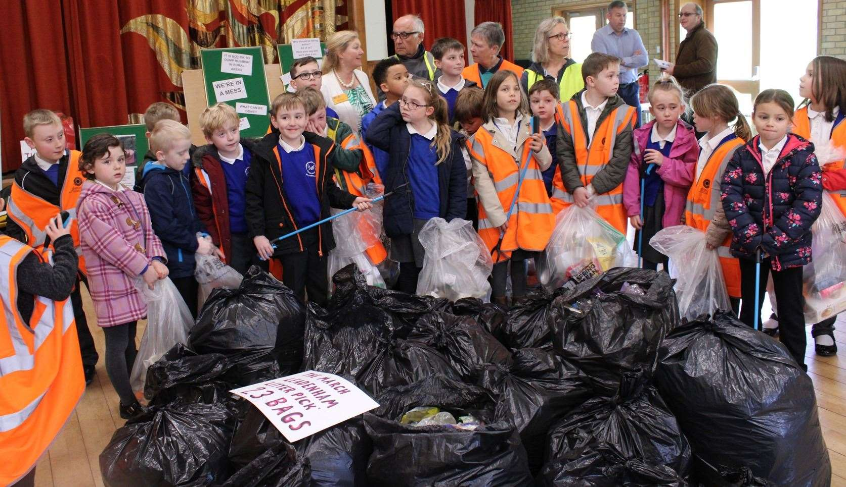 Pupils adding their litter to the 23 bags collected during March by Leadenham Litter Picking Group (8139665)