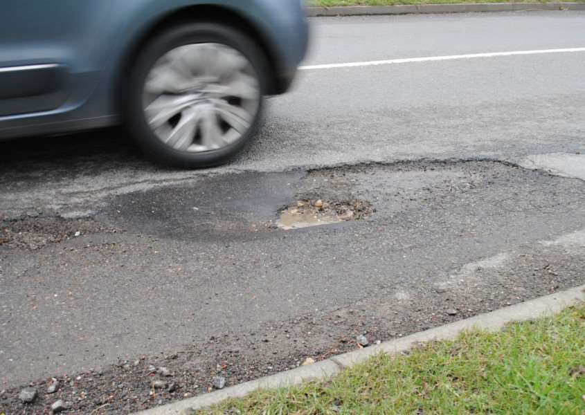 A pothole in Barrowby Gate, Grantham, where work is due to begin in early April to repair the road.