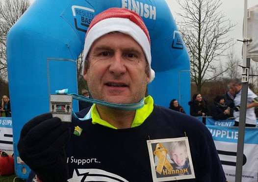 Simon after completing his 13th half marathon