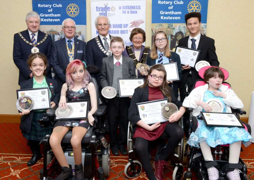 Children of Courage 2016: All of the award winners - from left Millie North, Jade Malone, Tyler Forster, Amberly-Mae Johnson, Emily Hollis, Ethan Blackman and Jade Illingworth, with from left back row, SKDC chairman Ray Wootten, president of the Rotary Club of Grantham Kesteven, Chris Thurlow, Rotary district governor Geoff Blurton, and Mayor of Grantham Jacky Smith.
