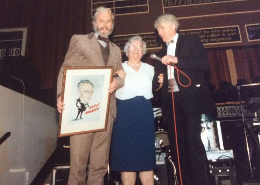 Widow Madge being presented with a Terry Shelbourne caricature of her husband Harry Sanders, with Dave France of Radio Lincolnshire.
