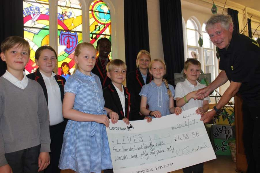Cheque ceremony: Pupils raised over �400 for the LIVES charity.
