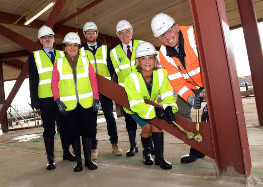 Signing the steels at the Poplar Farm School ceremony are, from left, Justin Ward, project manager for LCC, Coun Jacky Smith, of South Kesteven District Council, Tim Russell, Project Manager for Wates Construction, Paul Boucher, chair of CIT Trust Board, Jenny Wheeldon, principal of Poplar Farm School, and Peter Bell, chief executive of CIT Academies.