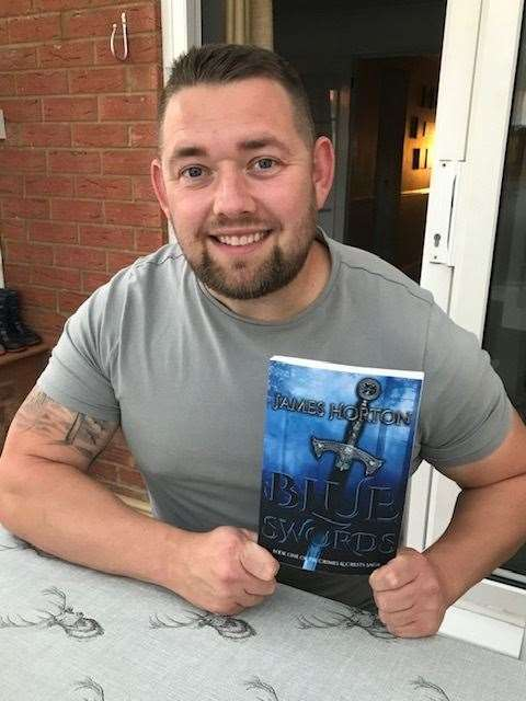 Police officer James Horton with his book, Blue Swords