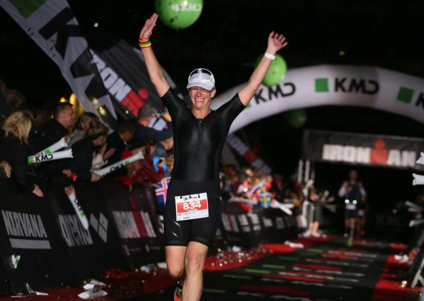 Louise Hyde crosses the Ironman finish line.