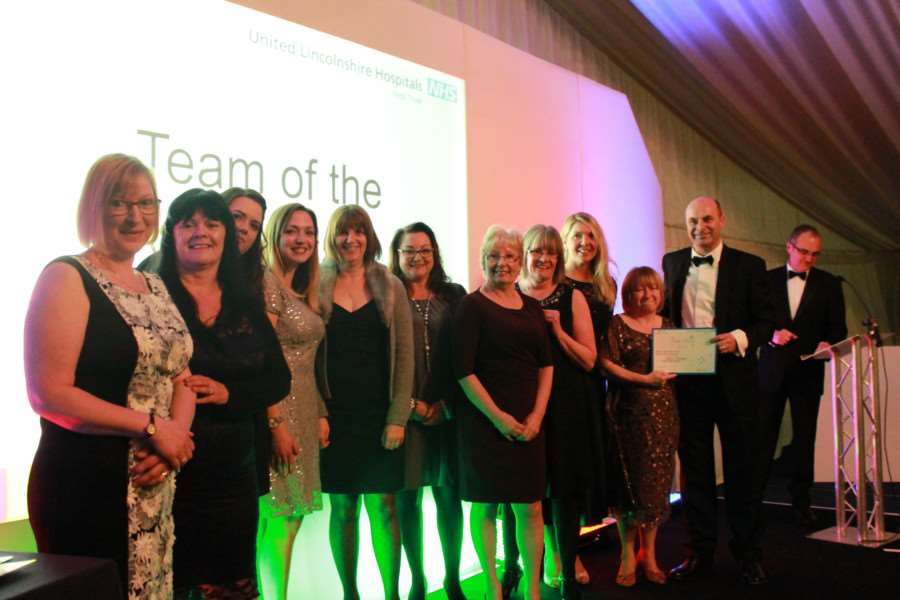 ULHT Awards: Team of the Year Award - highly commended staff from Ward 1 with Director of HR Ian Warren, right.