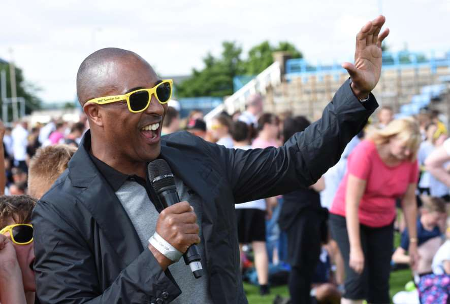 Olympian and World Champion hurdler Colin Jackson talks to the students at the Summer Cup at The Meres in Grantham.