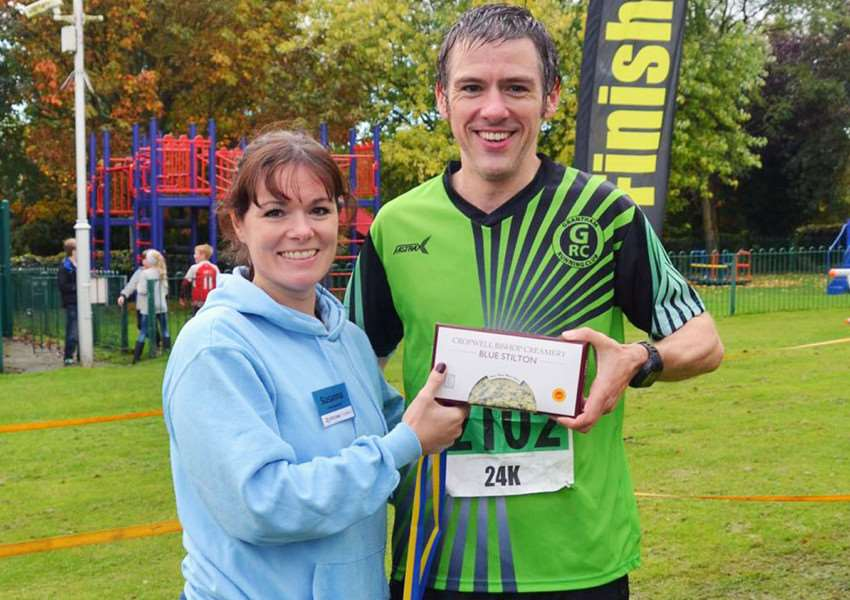 Matthew Kingston-Lee pictured being presented with his prize after winning the Stilton Stumble 24k on Sunday. Photo: Stilton Stumble