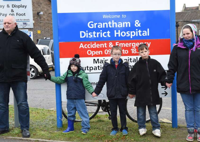 Families took part in the protest outisde Grantham Hospital by holding hands.