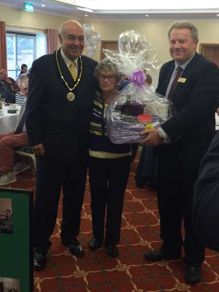 Coun Geoff Hazelwood and South Lincolnshire Blind Society president David Carter with raffle winner Jayne, from Grantham, at the society's centenary celebration.