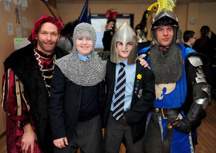Earlier this year the school started off its 100th anniversary celebrations with a truly historic day. Pictured: Headteacher Mark Anderson with students Jamie Smith, Noah Guiblin and Jonathan Harston of Knights of Middle England.