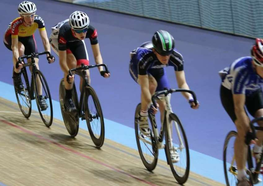 Robert McAndrew (third from left) on track at Derby Velodrome.