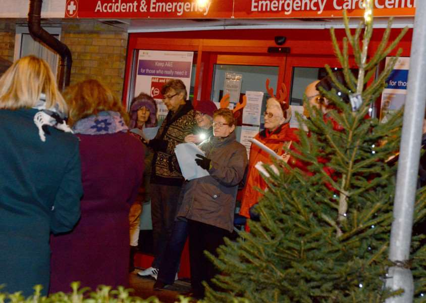 Carol singing outside Grantham Hospital's A&E department on Christmas Eve.