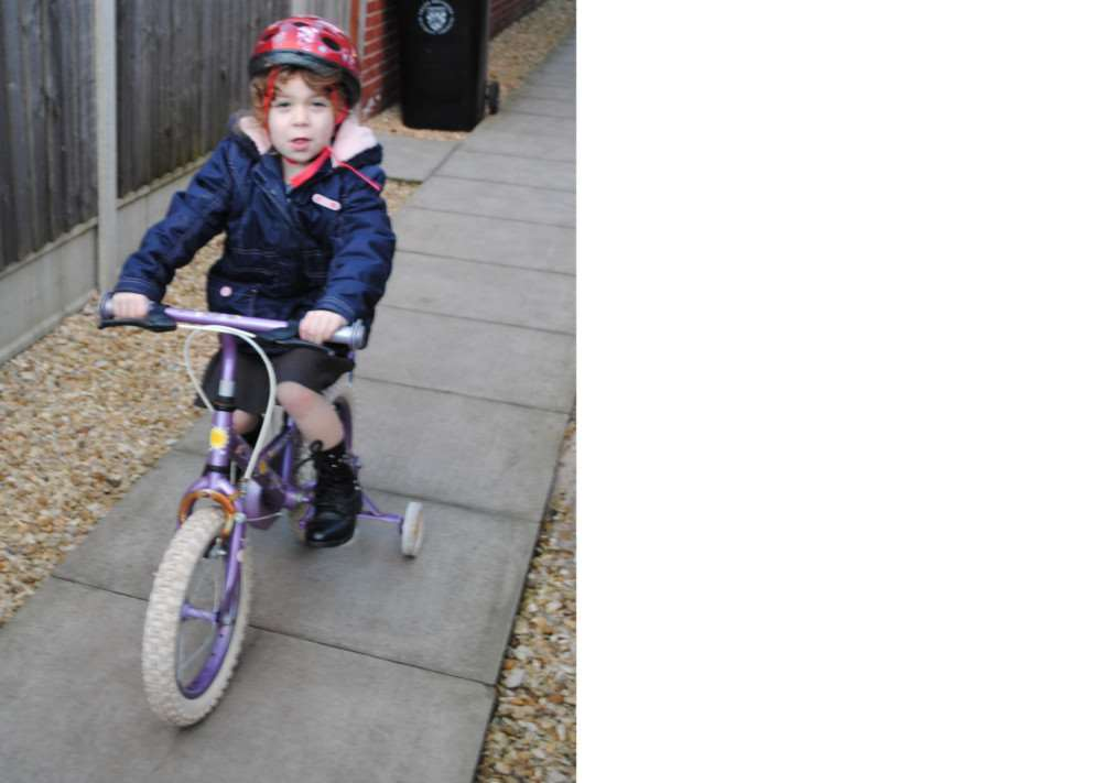 Sophie Lindley, 4, holds on tightly to her bike, following the warning that it would be taken off her.
