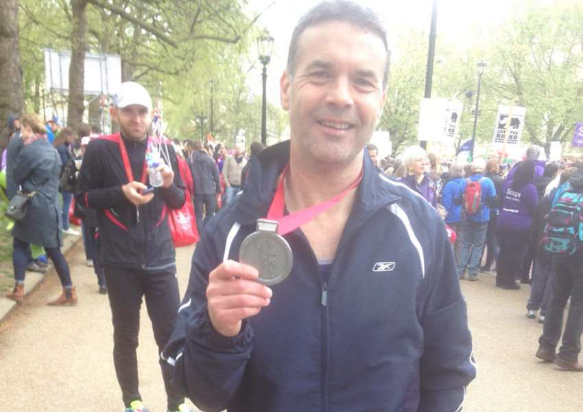 Nick Rossington with his London Marathon medal.